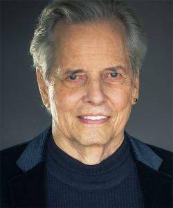 Mark W Travis